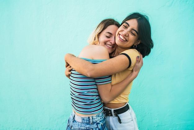 Loving lesbian couple hugging.