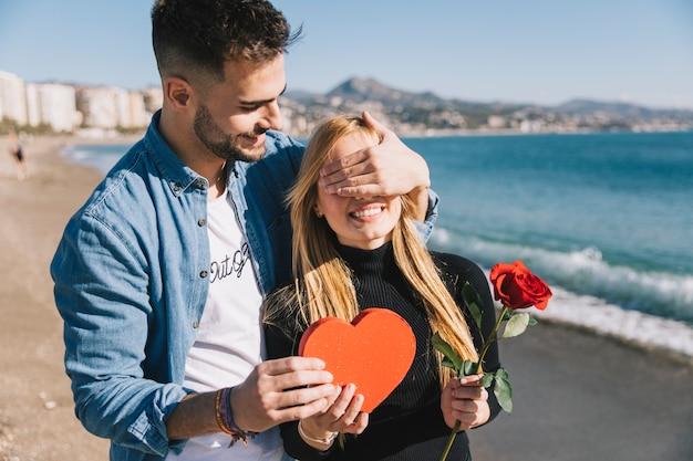 Loving man doing surprise for girlfriend