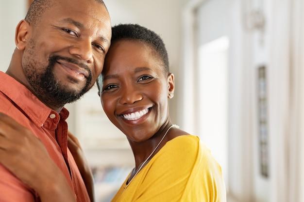 Loving mature couple looking at camera