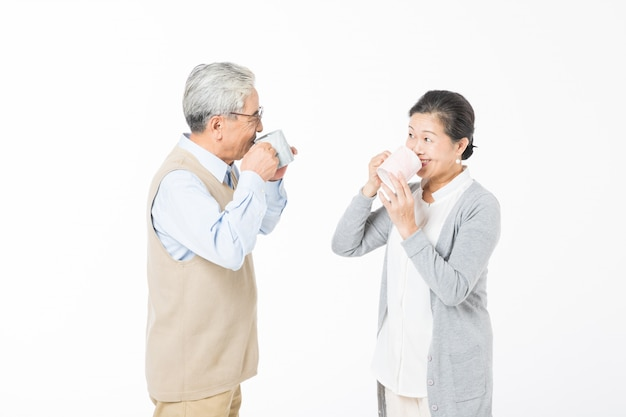 A loving old couple drinking water