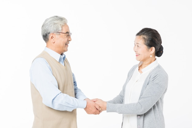 Loving old couples shake hands
