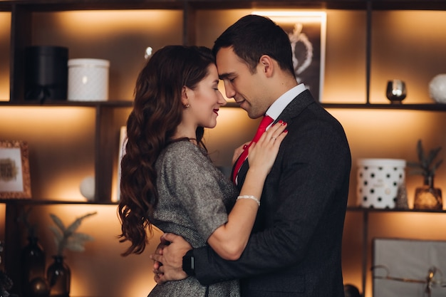 Loving romantic couple in festive clothing dancing