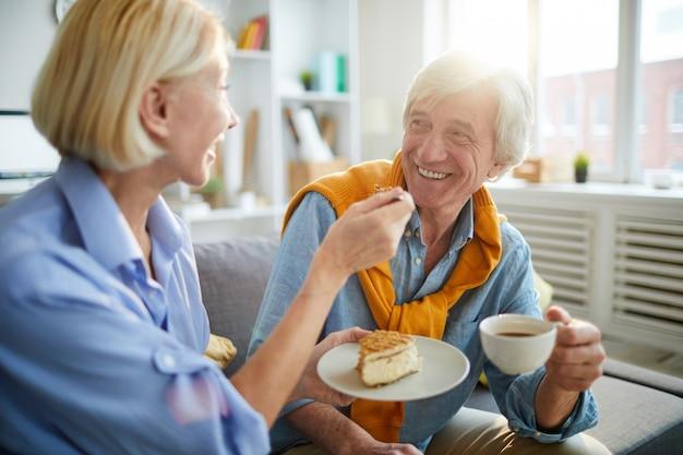 Loving senior couple enjoying coffee