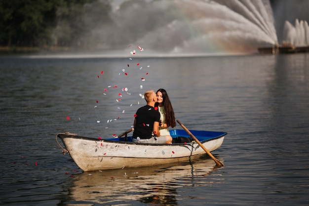 Loving young couple enjoying a boat on the lake