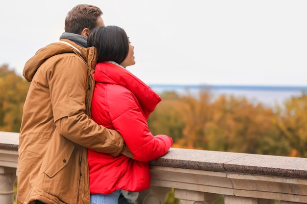 Loving young couple on romantic date in autumn park