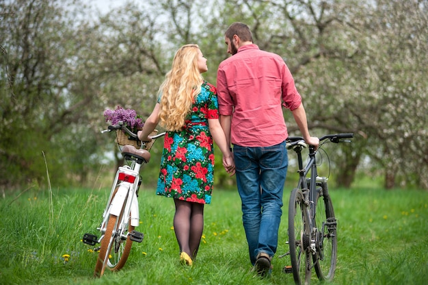 Loving young couple with bicycles