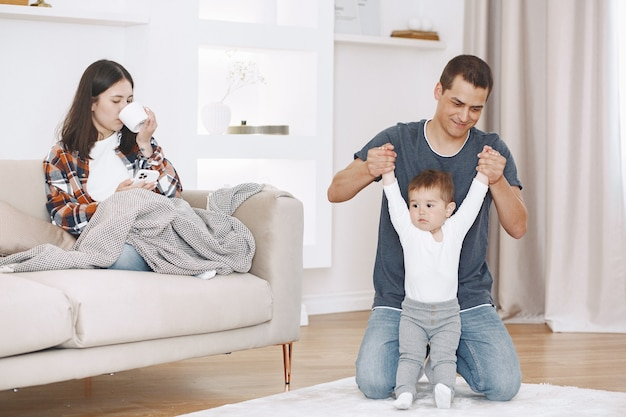 Loving young family relax and enjoy weekend time with little son playing together