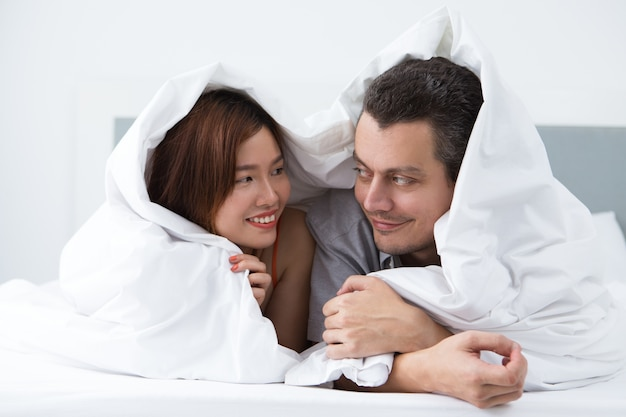 Loving young newlyweds resting in hotel room Free Photo