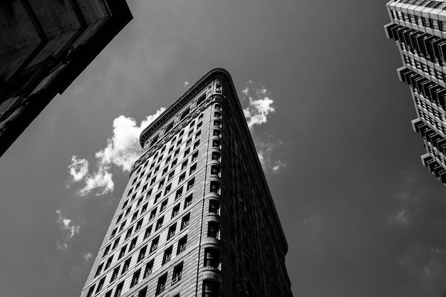 Low angle black and white shot of the flatiron building in nyc