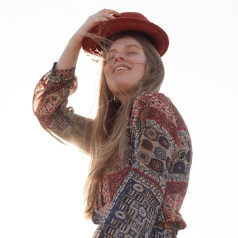 Low angle of bohemian woman posing with hat