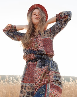 Low angle of bohemian woman posing