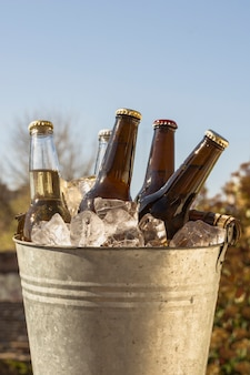 Low angle bucket with cold ice cubes and bottles of beer