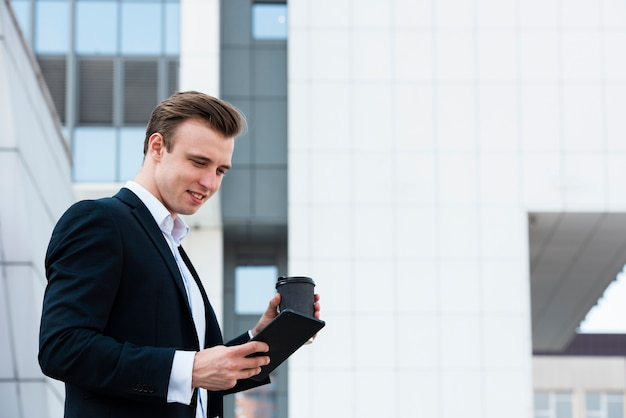 Low angle businessman using tablet