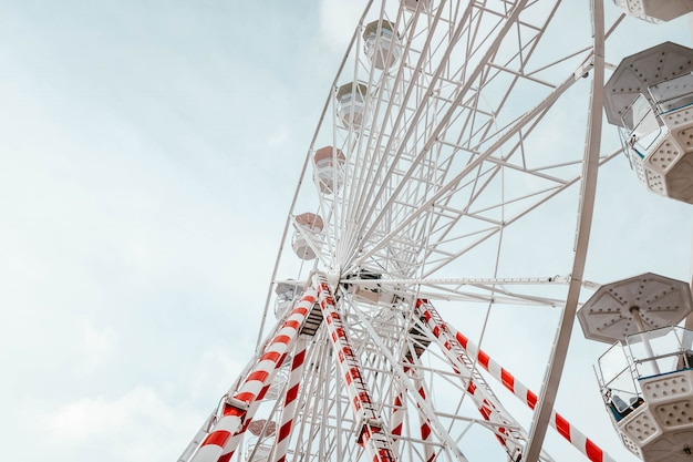 Low angle closeup of the ferris wheel carousel with red and white stripes on it