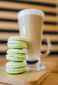 Low angle of coffee beverage with macarons