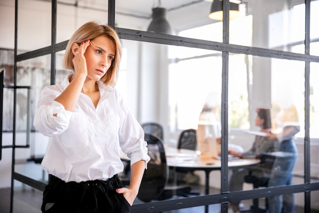 Low angle company employee thinking of strategy