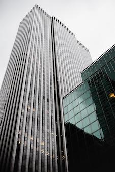 Low angle contemporary glass skyscrapers Premium Photo