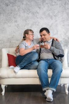 Low angle couple drinking tea