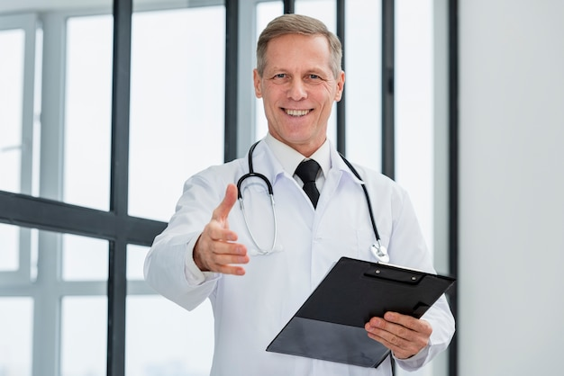 Low angle doctor with clipboard