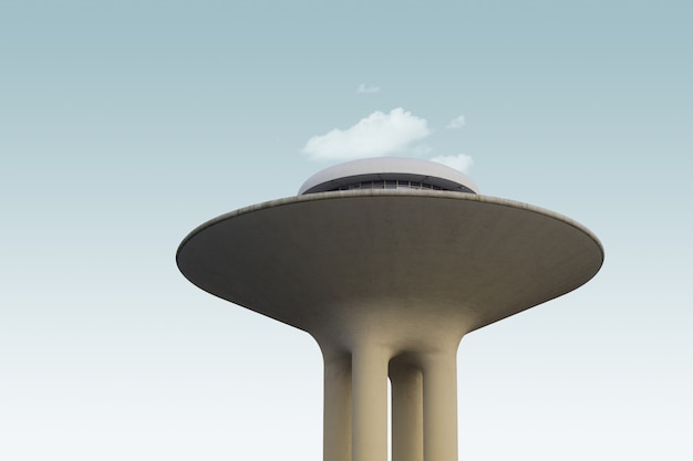 Low angle of an exotic modern structure under the clouds in the sky
