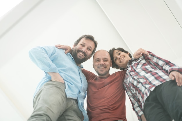 Low angle of father and sons sitting on glass