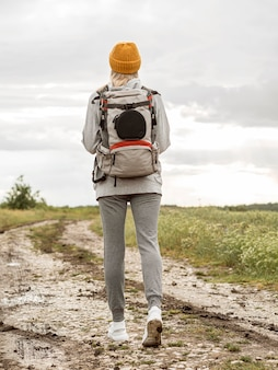 Low angle female with backpack