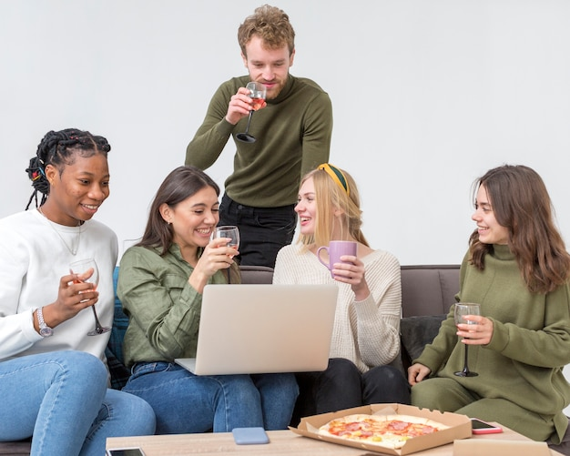 Low angle friends having pizza for lunch