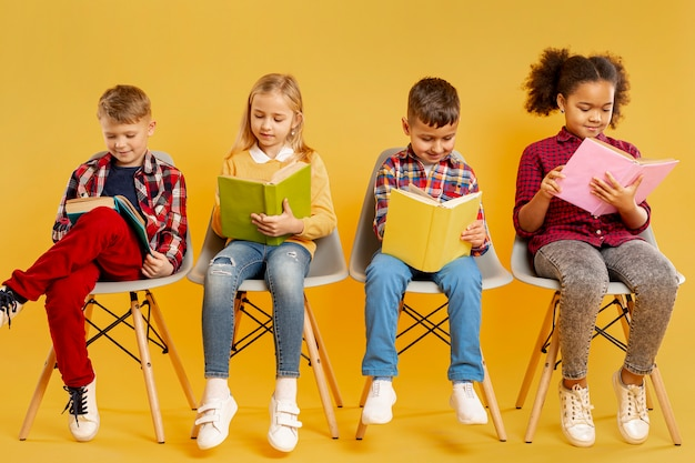 Low angle group of childrens reading