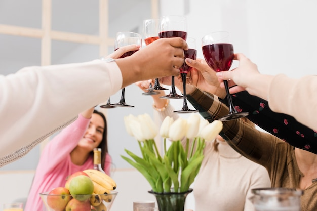 Low angle group of women making a toast