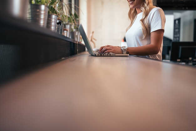 Low angle image of woman working on laptop. copy space.