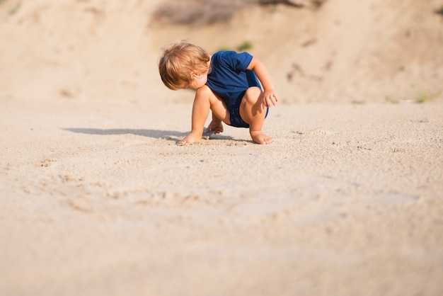 Low angle little boy at beach playing