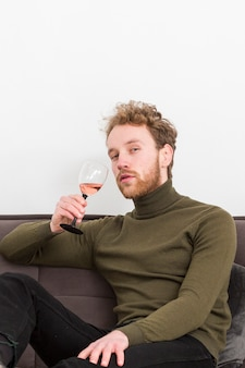 Low angle male drinking wine
