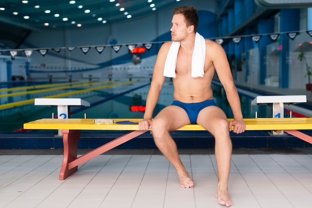 Low angle male swimmer having break