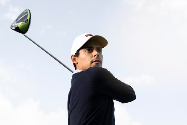 Low angle of man with golf club
