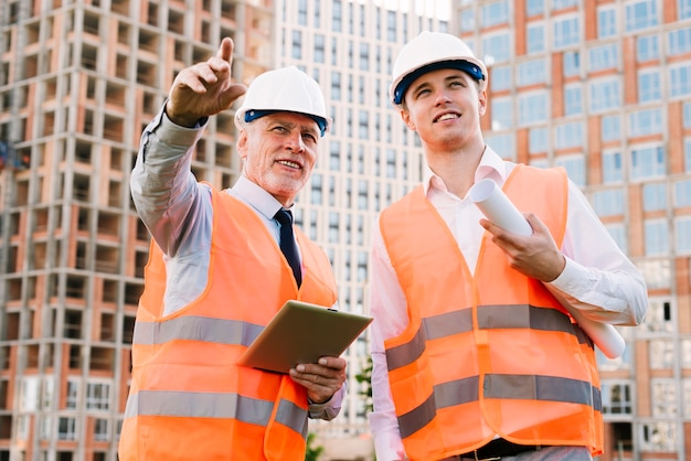 Low angle men with safety vests