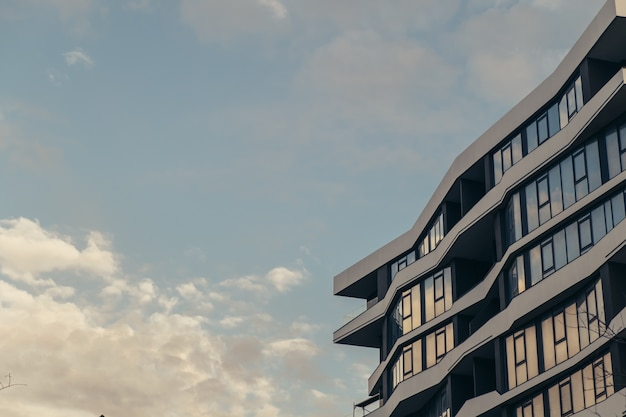 Low angle modern building with clouds skyscraper