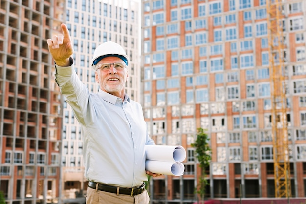 Low angle old man pointing at something