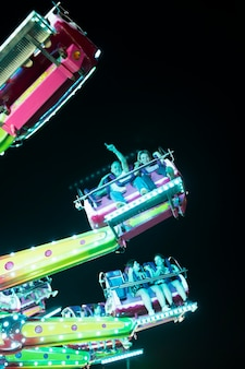 Low angle people in amusement ride