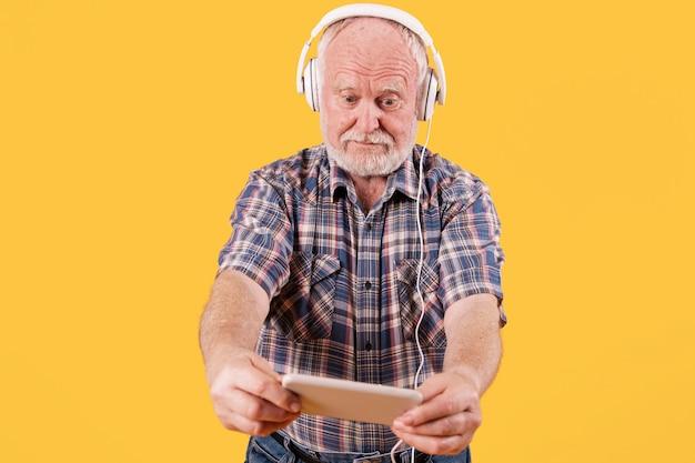 Low angle senior listening music