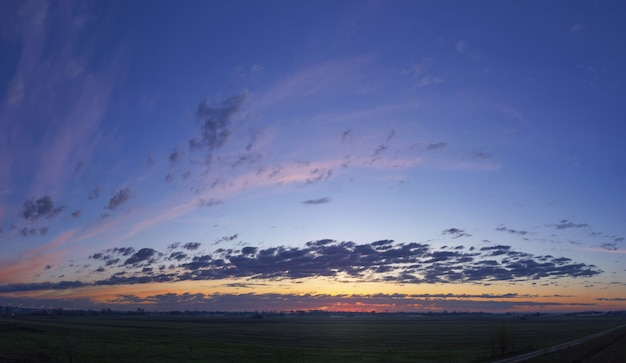 Low angle shot of the beautiful sky with cloud formations during sunset