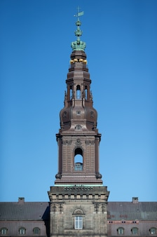 Low angle shot of the christiansborg palace tower on a clear sky