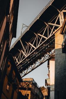Low angle shot of a gray concrete bridge in portugal