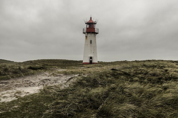 Low angle shot of the lighthouse list east at sylt, germany under the storm clouds