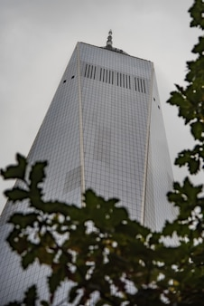 Low angle shot of a modern architectural building with a white sky