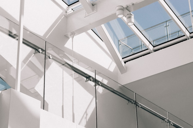 Low angle shot of a modern building interior with white walls touching the sky