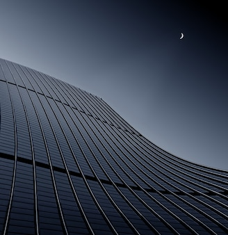 맑은 하늘을 만지고 현대적인 비즈니스 빌딩의 낮은 각도 샷