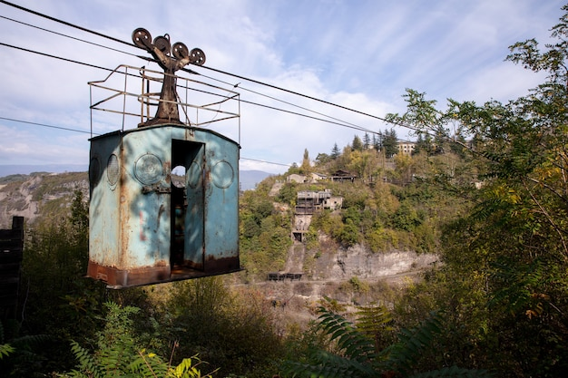 Low angle shot of an old abandoned ropeway in the middle of a mountainous scenery