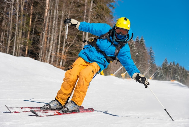 Low angle shot of a professional skier skiing on the slope