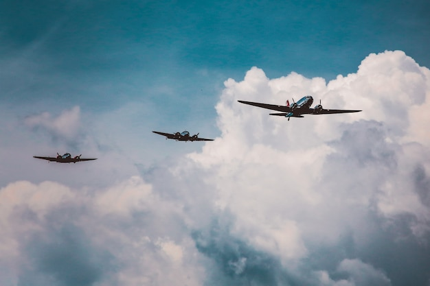 Low angle shot of a range of aircraft preparing an air show under the breathtaking cloudy sky
