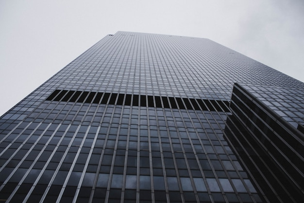A low angle shot of a tall skyscraper business building in nyc